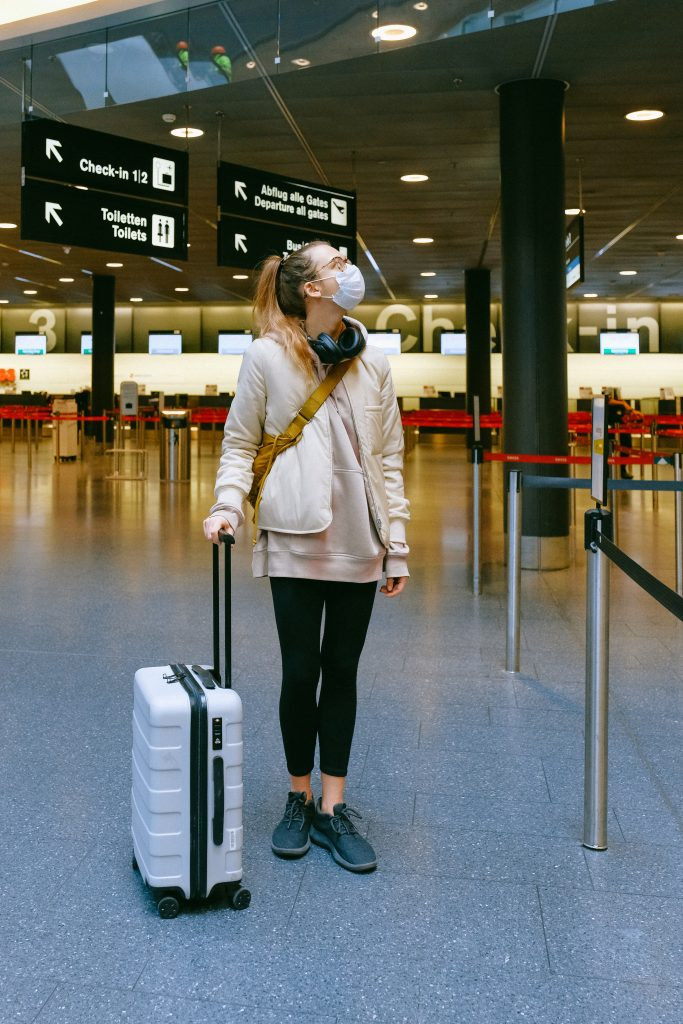 woman in airport covid